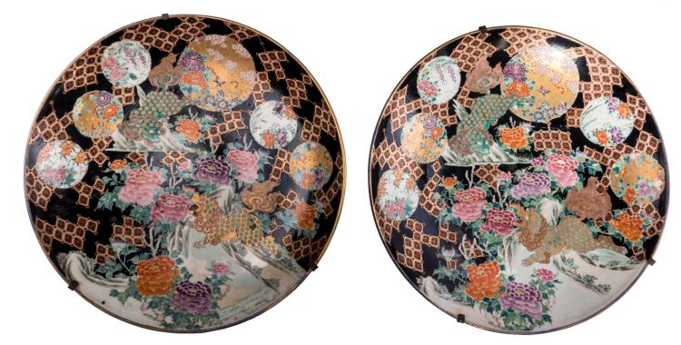 A pair of polychrome and gilt decorated Japanese chargers, with floral and geometric motifs and two Chichi, Edo period, H 9,5 - ø 65,5 cm