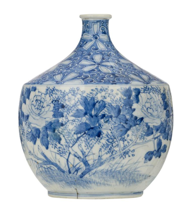 A Japanese blue and white decorated vase with flower branches and a bird, Meiji and period, H 24 cm