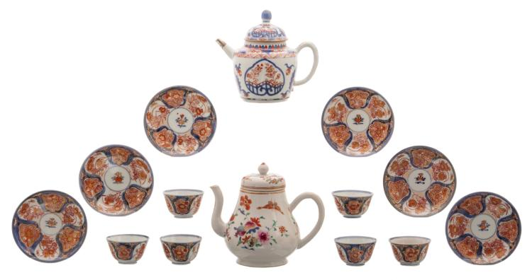 A Chinese Imari teapot and cover with silver mount and six cups and saucers, 18thC; added a ditto famille rose floral decorated teapot and cover with butterflies, fruits and flower branches, 18th - 19thC, H 3 - 16 cm