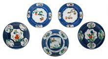 Five Chinese bleu poudré dishes, the roundels famille verte, decorated with birds, insects, flower branches and landscapes, some with a symbol mark, H 3 - 4,5 - ø 22 cm