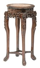 A Chinese richly carved hardwood stand with marble top,H 91,5 - D 45 cm