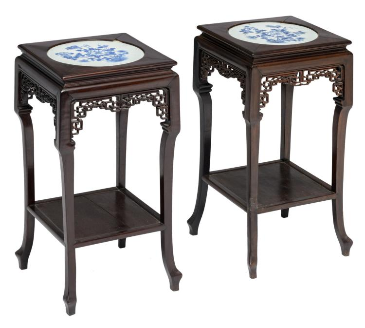A pair of Chinese quadrangular carved hardwood occasional tables, the top decorated with a porcelain blue and white decorated plaque with a bird and flower branches , H 75 - W 36 - B 36 cm