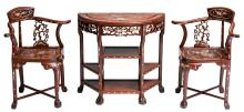 An Oriental crescent shaped wooden side table with mother-of-pearl inlay, with the two matching arm chairs, H 78 - 85 - W 82 - D 40 cm