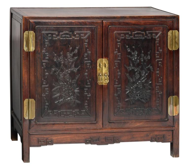 A Chinese carved two doors buffet with brass mounts, the panels with flower branches, about 1900, H 88 - W 98 - 42,5 cm