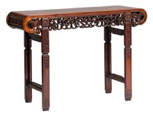 A Chinese carved hardwood side table with open work lotus and funghi decoration, H 83,5 - W 120 - D 40,5 cm
