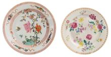 Two Chinese 18thC famille rose plates decorated with flowers and the attributes of the literati, ø 31,5 - 35,5 cm