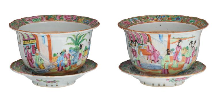 A pair of Chinese Canton famille rose floral decorated jardinieres with the matching plates, the jardinieres overall decorated with a court scene, 19thC, H 13 (without matching plate) - 15 (with matching plate) - ø 21 - 22 cm
