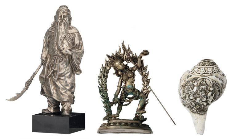 A Tibetan pacton Vajrapani; added a Tibetan conch shell; extra added a Chinese silver plated pewter deity on a marble base, H 9,5 - 30,5 cm
