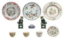 Two Chinese famille verte Fu lion temple guards, 18thC; added three Chinese famille rose and famille verte dishes, three cups and one saucer, some marked, 18thC; extra added a Chinese flower shaped water pot, H 4,5 - 14,5 - ø 8 - 23 cm
