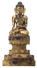 A Burmese gilt lacquered wooden seated Buddha, on lotus base, with a calligraphic text, about 1900, H 64,5 cm