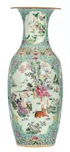 A Chinese turquoise ground famille rose floral decorated vase, the roundels with figures in a landscape, birds and flower branches, with a Qianlong mark, H 57,5 cm