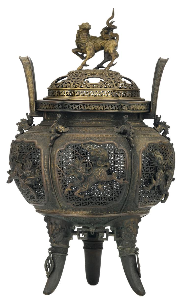 A Chinese open work and relief decorated bronze tripod incense burner with kylins, phoenix and key pattern, marked, 19thC, H 68,5 cm