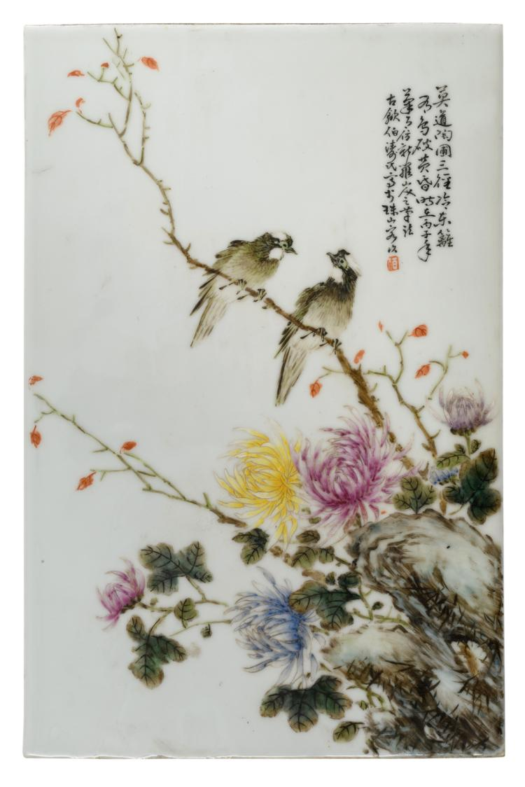 A Chinese famille rose decorated plaque with a rock, birds and flower branches, with a calligraphic text, signed, 25,5 x 38,5 cm