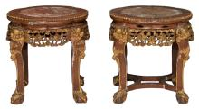 A pair of Chinese carved and polychrome decorated gilt hardwood stools with a marble top, H 45 - ø 44 cm