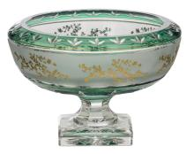 A decorative green overlay Val-Saint-Lambert crystal cut bowl on foot, acid-bitten frieze and relief decorated gilt flower branches, pièce unique 94/599, H 18,5 - ø 26 cm
