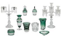 Two glass girandoles; added eight green overlay Val-Saint-Lambert crystal cut decorative items and utensils, H 4 - 45 cm