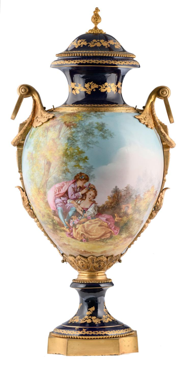 An impressive bleu royal and gold decorated vase in the Sèvres manner, with a gallant scene signed 'Jeanne' and gilt bronze mounts, H 100 cm