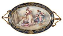 A bronze mounted plate in the Sèvres manner, decorated with a gallant scene signed Bourbois, H 22 - W 57 - D 31 cm