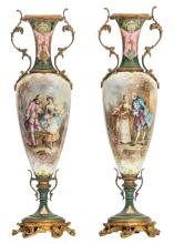 A pair of ornamental gilt bronze mounted green ground vases in the Sèvres manner, the roundels decorated with gallant scenes signed 'Poitevin E.', H 71 cm