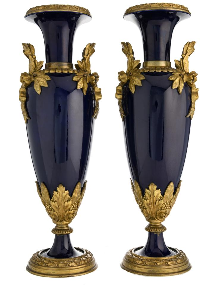 A pair of bleu royal bronze mounted Sèvres vases, H 51 cm