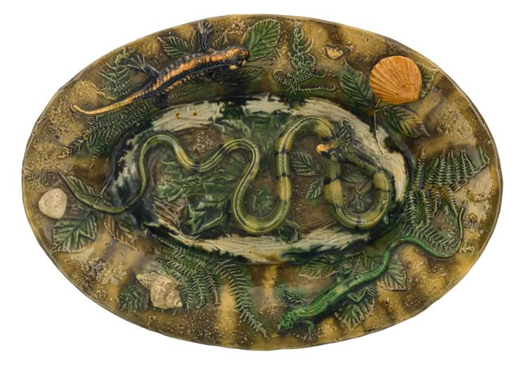 A polychrome and relief decorated earthenware plate in the manner of Palissy, Polakowski & Cie​ - Roumazières (Ch.), 29 x 41 cm