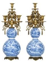 A pair of late 17thC blue and white double gourd vases in the Delft manner, transformed into candlesticks with 19thC Renaissance revival brass mounts, H 61 cm