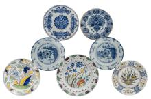 Seven 18thC tin glazed blue and white and polychrome Dutch Delftware plates, ø 29 - 34,5 cm