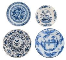 Four 17th and 18thC tin glazed blue and white Dutch Delftware plates, ø 30 - 35 cm