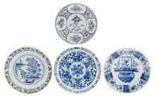 Four 18thC tin glazed blue and white Dutch Delftware plates, ø 35 cm