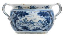 An 18thC Dutch Delftware jardiniere, blue and white decorated with a hunting scene, marked J.D.T.(Jan Theunis Dextra - 'De Grieksche A'), H 19,5 - ø 37 cm