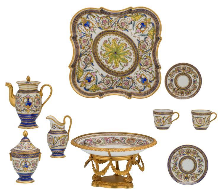 A Historism French polychrome decorated porcelain tête-à-tête set, marked'M. Imple de Sèvres'; added a ditto dish with the monogram of Louis-Philippe and gilt bronze mounts, marked'Sèvres - Chateau de F. Bleau', H 2 - 14 cm