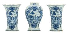 Two Dutch Delftware blue and white octagonal vases; added a matching vase, 19thC, H 22,5 - 24 cm