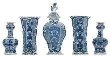 A Dutch Delftware blue and white three-piece garniture, marked 'Lampetkan'; added two 18thC blue and white Dutch Delftware garlic vases, H 24 - 33 cm