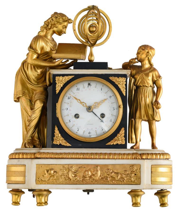 A gilt bronze mantle clock on a white Carrara marble base, the dial marked 'A Paris', H 36 cm