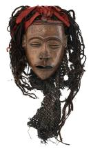 A traditional African mask, H 60 - W 30 cm