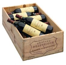 Twelve bottles Saint-Estèphe 'Château Beauséjour', 1986, in a wooden box