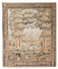 A Flemish or French wool and silk verdure tapestry in the 17thC manner depicting a flamingo and a swan in a hilly landscape,266,5 x 332 cm