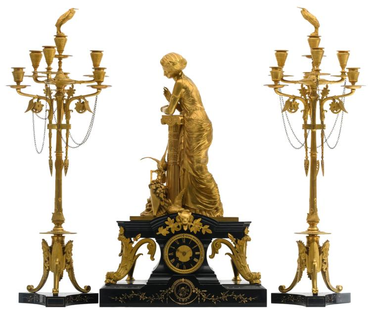 An exceptional French gilt bronze Neoclassical three-piece garniture on a black Rance marble base, the work marked Barrard & Vignon, second half of the 19thC, H 75,5 - 79,5 - W 32 - 49 cm