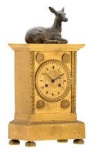 A gilt brass mantle clock with on top a bronze doe, second half of the 19thC, H 41 - W 20 - D 12 cm