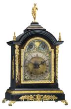 A Neoclassical English gilt bronze and brass mounted ebonised wooden bracket clock, the work marked'W. & H. Sch.', about 1900, H 56 - W 33,5 cm