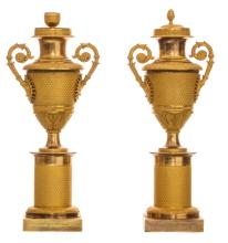 A pair of second quarter of the 19thC Neoclassical gilt bronze vases and covers, H 36 cm