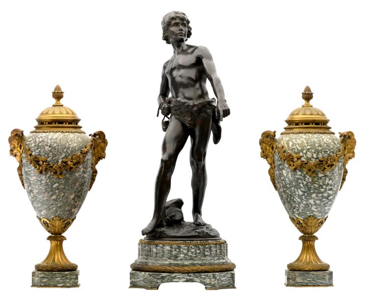 A 19thC Neoclassical vert de mer marble and gilt bronze mounted three-piece garniture, the centerpiece crowned with a David figure, signed Moreau L., H 48,5 - 55,5 cm