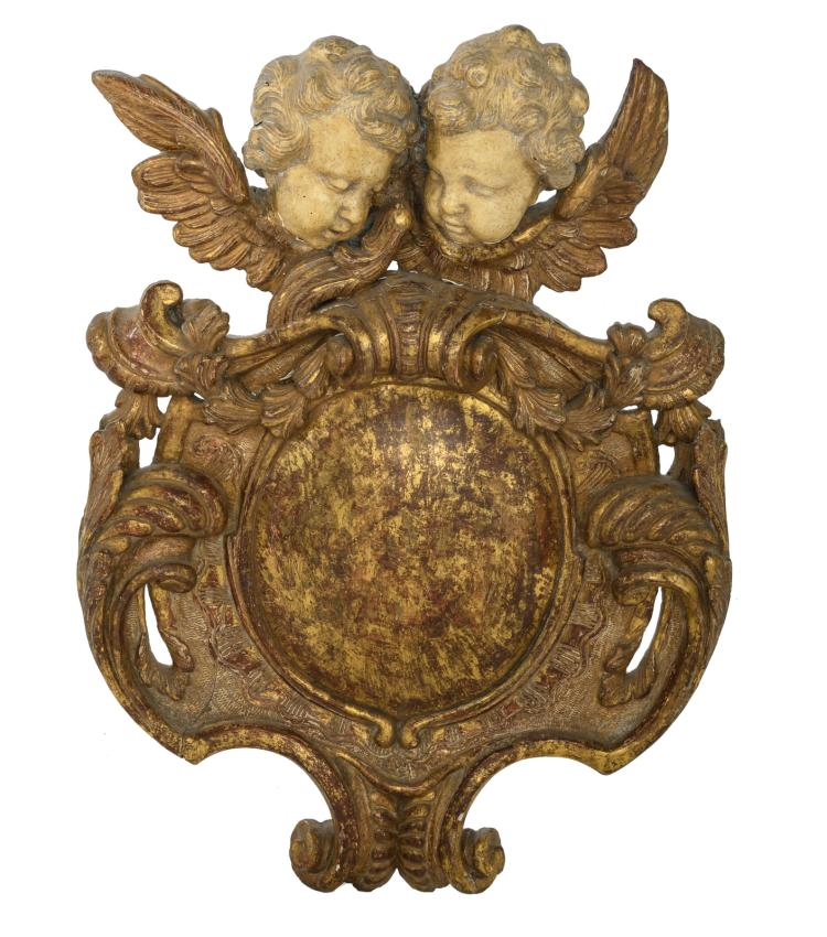 A first half of the 18thC cartouche crowned with two angel heads, H 68 cm