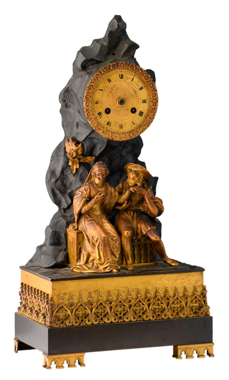 A 19thC French Gothic revival patinated and gilt bronze mantle clock in so-called 'Style Troubadour', the work marked'B.P & F. - Paris', H 43 - W 22 cm