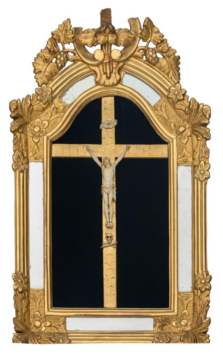 An ivory 19thC corpus Christi, in a rustic mirror frame, H 65 cm