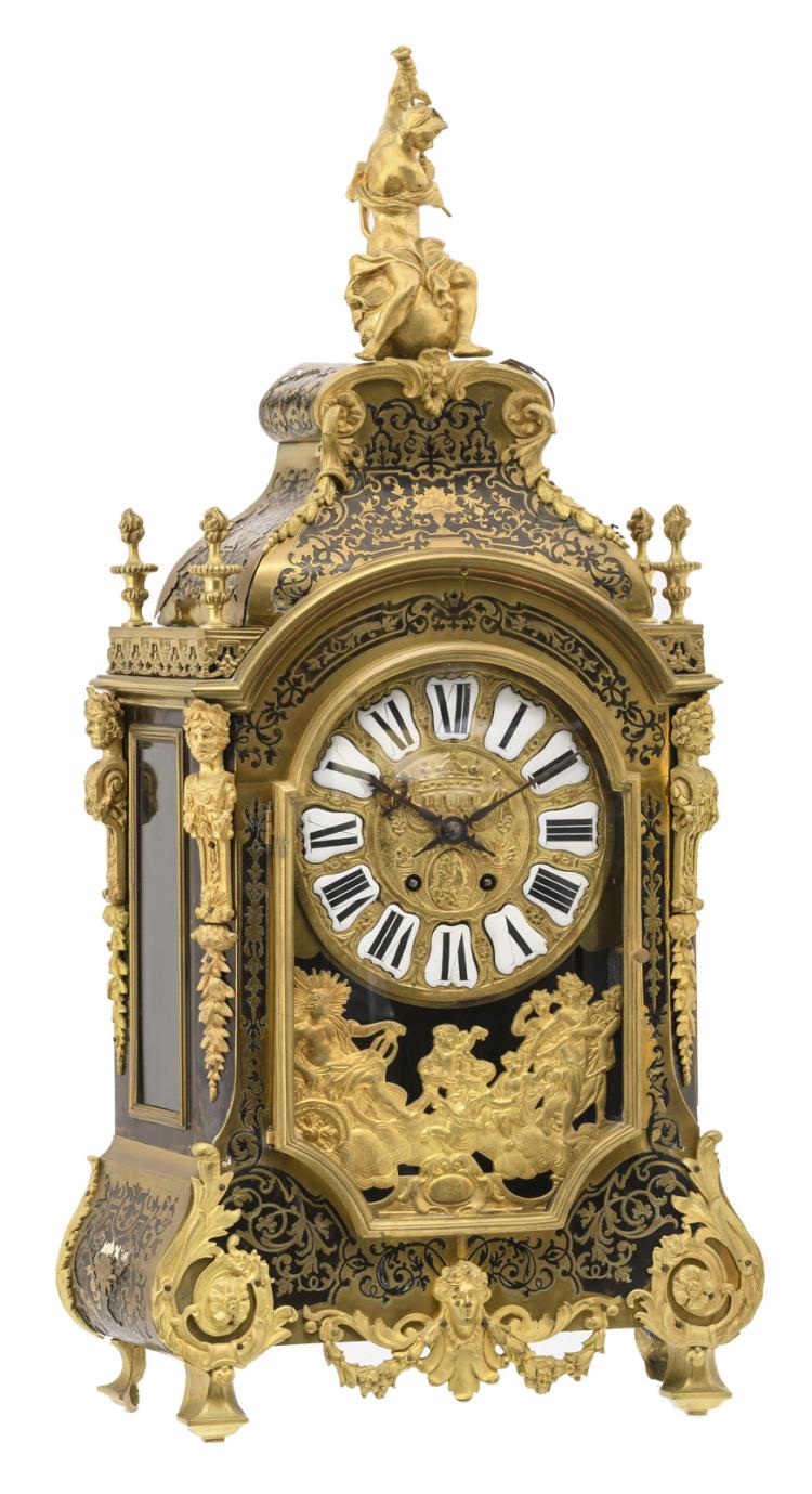 A second half of the 19thC Neoclassical Boulle cartel clock, gilt bronze and brass mounts and ebonised wood, the work marked'S. Marti et Cie', H 84,5 cm