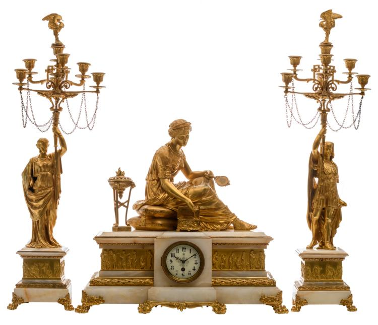 A second half of the 19thC exceptional probably French gilt bronze three-piece garniture on an onyx marble base depicting Cleopatra flanked by two courtiers and signed A. Habert, the work marked,H 56 - 77,5 - W 20 - 60 cm