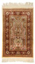 An Oriental silk and silver thread woven carpet, 43,5 x 68,5 cm