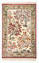 An Oriental carpet, silk and wool on cotton, floral decorated, with birds and deers, 63 x 164 cm