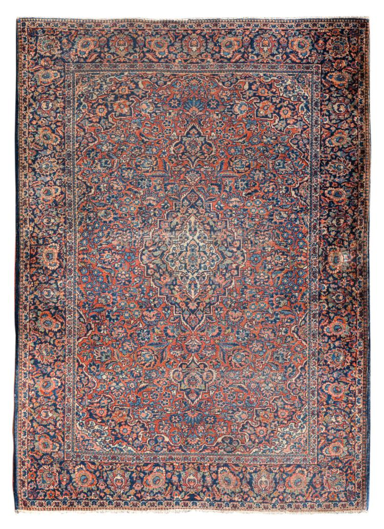 An Oriental carpet, wool on cotton, decorated with floral motifs and a central medallion, 134 x 189 cm